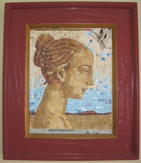 "9""x 11"" - This mosaic, with its pensive icon like figure and vast looking background, is executed with very small tesserae."